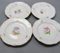 A set of four Meissen dishes, painted with scattered floral sprigs