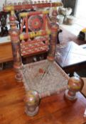 A painted carved Indian low seat chair, W.48cm, D.48cm, H.76cm