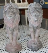 A pair of reconstituted stone lion garden ornaments, H.54cm