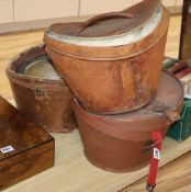 Three silk top hats and leather hat boxesCONDITION: All leather top hat boxes are damaged, the