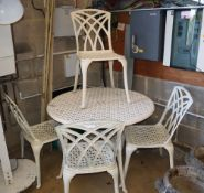 A circular painted metal garden table and four chairs, table 110cm diameter, H.74cm