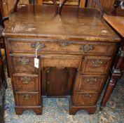 A George I style walnut kneehole desk, W.74cm, D.44cm, H.77cm