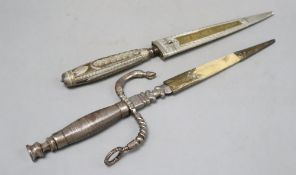 An Italian 19th century dagger stiletto, engraved silver mounts, horn grip, brass sheath sides