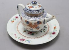 A 18th century Chinese famille rose dish, diameter 23cm, and an Imari porcelain teapot