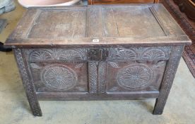 An 18th century carved panelled oak coffer, W.96cm, D.49cm, H.62cm