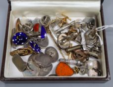 A group of assorted cufflinks including silver.