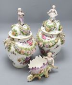 A pair of Augustus Rex floral encrusted porcelain vases and covers and a similar putti