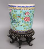 A Chinese turquoise glazed 'dragon' jardiniere and wood stand, overall 33cm