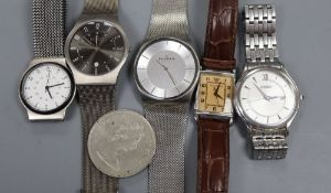 Five assorted gentleman's wrist watches including Skagen and Seiko and a coin.