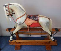 An F.H. Ayres dapple grey rocking horse, L.128cm, H.114cm