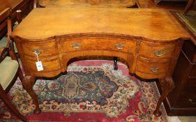 A walnut serpentine front dressing table, Width 107cm