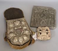 A Tibetan Ghau prayer box, white metal-mounted with inset figure of Buddha, in silk carrying case