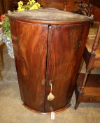 A George III mahogany bow-fronted hanging corner cupboard, Width 61cm