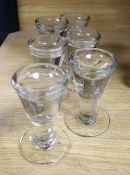 A set of six glass pennylicks, height 9cm