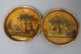 A pair of Continental japanned coasters, diameter 13cm