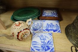 A Creamware teapot, green leaf plates and Delft tiles