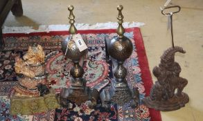 A pair of Punch and Judy door stops (one painted) and a pair of Dutch style fire dogs with sphere