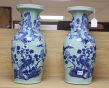 A pair of Chinese vases with dragon design, height 48cm