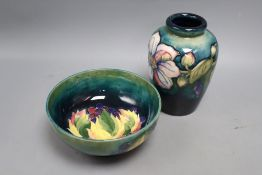 A Moorcroft leaf and berry bowl and a Clematis pattern vase, height 15cm