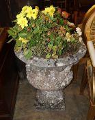 A reconstituted stone garden urn, Height 68cm