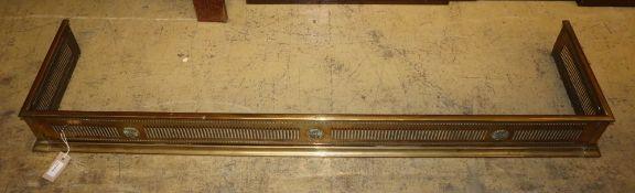 A pierced brass fender, Length 134cm