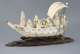 A large Japanese sectional ivory and whale tooth model of the Takarabune, Meiji period, the seven