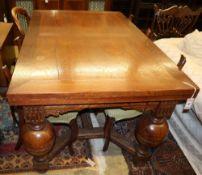 An 18th century-style, Dutch design oak draw leaf dining table, 135 x 90cm