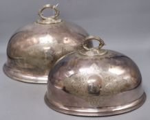 Two Victorian silver plated meat dish covers, largest 35 x 28cm