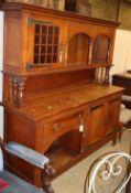 An Arts & Crafts oak raised back sideboard, W.176cm, D.54cm, H.185cm