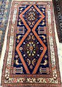 A Kurdish blue ground rug, 226 x 112cm