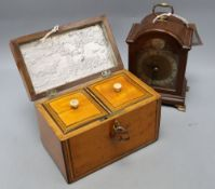 A George III satinwood tea caddy, width 19cm, and a mahogany mantel clock