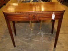 A George III mahogany D-shaped tea table with folding top, Width 90cm