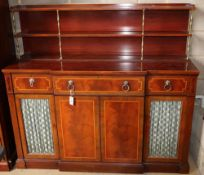 A Regency style satinwood banded mahogany breakfront secretaire cabinet, W.152cm, D.50cm, H.138cm