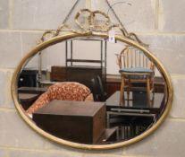 An Edwardian oval giltwood and gesso wall mirror (a.f.), W.92cm, H.76cm