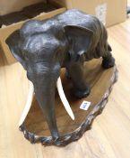 A Japanese Meiji bronze elephant, signed, length 42cm