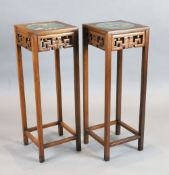 A pair of Chinese hardwood vase stands, each inset with cloisonne panels depicting birds on a branch