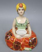 Henri Delcourt, Boulogne-Sur-Mer. A porcelain inkwell modelled as a figure of a genie, height 16cm