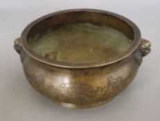 A Chinese bronze censer with lion mask handles, Xuande mark, but later, diameter 16cm