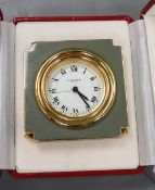 A Cartier travelling clock with box and papers