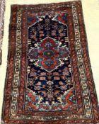 A Kamadan blue ground rug, 145 x 98cm