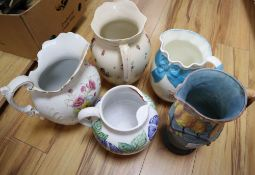 A Carltonware jug and four other ceramic jugs, tallest 31cm