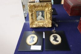 A 19th Century English School miniature portrait of a young lady in ornate gilt frame and two