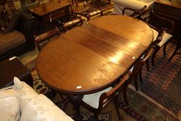 A 1920's mahogany extending dining table with two leaves and winder, extends to 175cm