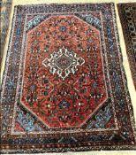A Kurdish red ground rug, 205 x 154cm