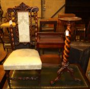 A Victorian carved walnut prie dieu chair and a walnut candle stand on barleytwist column