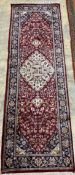 A Caucasian blue ground rug, 128 x 89cm, a Persian style red ground mat and a gold ground rug