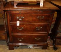 A 19th century style walnut chest with brushing slide and three drawers, Width 66cm