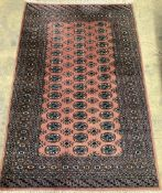 A Bokhara style pink ground rug, 194 x 131cm