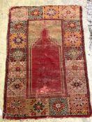 A Caucasian red ground prayer rug, 121 x 82cm
