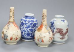 Two Satsuma bottle vases, miniature Chinese blue and white vase, Qianlong mark to base and a Chinese